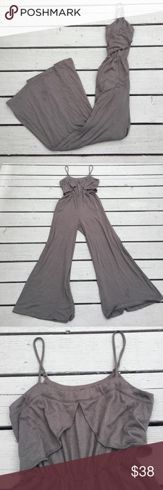 SMALL Flowy Olive Green Jumpsuit/Romper This jumpsuit is super comfy and flattering! The top has two ruffles over the bust with adjustable straps. The legs are wide and move with you as you walk, there is a small hole in one of the pant legs. There is elastic under the busy, it is a size small but I usually wear a medium so it is a bit roomy! Coincidence & Chance Pants Jumpsuits & Rompers