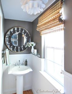 Great website showing paint colors in actual rooms. Plus this is a great powder room!