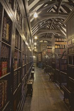 """stylish-homes: """" Dark wood stacks and beautifully vaulted ceiling in Chetham's Library in Manchester, England, which is the oldest free public reference library in the United Kingdom. Beautiful Library, Dream Library, Old Libraries, Bookstores, Public Libraries, Fantasy Places, Fantasy Landscape, Of Wallpaper, British Museum"""