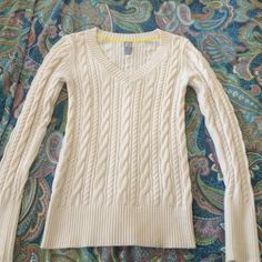 Cream cable knit v-neck sweater JCP cream sweater great for layering and winter. Worn a handful of times. Great used condition. Ask away  jcpenney Sweaters V-Necks