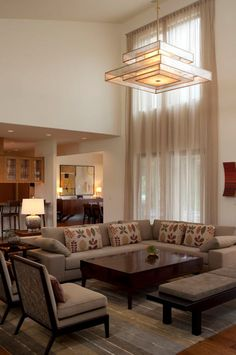 Curtain idea 43: Cover odd windows with ceiling to floor sheer drapes.