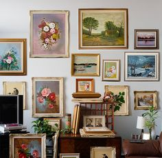 Raid yard sales and artist friends (use thrift store frames if necessary) for gallery wall in cozy spare bedroom
