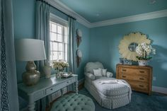 A private gallery hall connects the master bath to the stylish, expansive dressing room and master closet .  A calming, beach-inspired color palette embraces the elegant dressing room, creating an intimate spot to relax and get ready for any occasion. #HGTVDreamHome