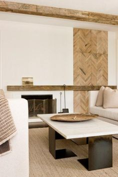 Rustic wood in a herringbone pattern adds warmth to this modern family room. #darrylcarter