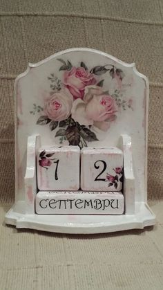 Wood calendar painted white with pink roses decoupaged onto it