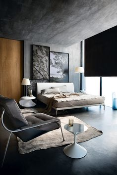 Beautiful Bedroom - neutral colors, grey walls & ceiling, cool art work, black shades.