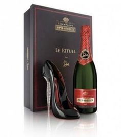 Louboutin launched his own champagne in partnership with champagne house Piper Heidsieck. To commemorate, they released a limited edition Le Rituel box set. The ritual, dating back to the 1880's, is emblematic of Europe at it's peak ~ drinking from the shoe of a woman. The crystal heel stiletto designed by Louboutin has the signature red sole.