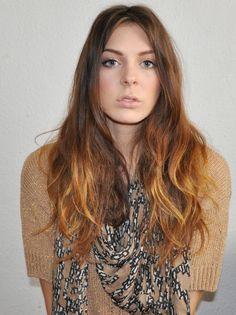 Reddish ombré hair.