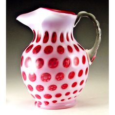 Fenton Glass Coin Dot Cranberry Opalescent Jug or Pitcher with Ice Lip.  For more information >Click here: http://www.mainelyglass.com/art-glass/fenton-coin-dot-cranberry-opalescent-no-1353-jug-pitcherice-lip Take 10% off and get FREE SHIPPING with coupon code NEW10