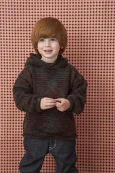 A self-striping colorway of Vanna's Choice can create a lovely unique pattern seen in this knit hooded sweater.
