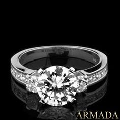 round engagement ring with princess cut diamonds on side!
