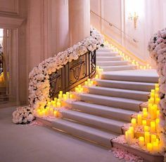 """Can't take our eyes off this magical floral stairway by @jeffleatham! We're so mesmerized with the abundance use of pink flowers all along the stairs,…"""