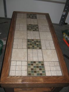 DIY tile a table top. Hmmm, I have a table with missing glass. This just might work.