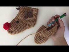 Comfy crochet slipper socks for the holidays! Simple embellishments create a cute little Rudolph face on these brown crocheted socks. The best part is that the slipper socks work up in one… Diy Crochet Patterns, Crochet Shrug Pattern, Crochet Slipper Pattern, Crochet Flower Tutorial, Knitting Patterns, Crochet Ideas, Crochet Baby Sandals, Crochet Slippers, Baby Christmas Hat