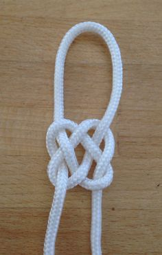 How To Tie A Celtic Square Knot - DIY Tutorial - Guidecentral. Guidecentral is a fun and visual way to discover DIY ideas learn new skills, meet amazing people who share your passions and even upload your own DIY guides. We provide a space for makers to Rope Knots, Macrame Knots, Macrame Square Knot, Paracord Projects, Macrame Projects, Paracord Ideas, The Knot, Jewelry Knots, Celtic Knot Bracelets
