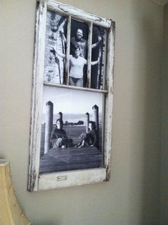 Old window with black and white enlarged family photos