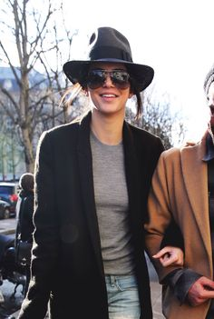 Kendall Jenner. Hat. Oversized Aviator Sunglasses. Grey RIbbed Knit. Black Long Line Wool Coat.