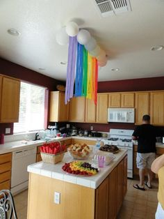 Rainbow above the food - streamers and balloons (Rainbow Party).