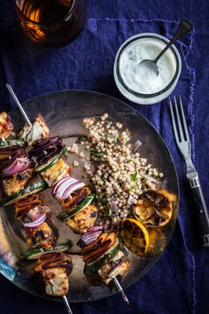 Moroccan fish skewers with barramundi are flavorful, spiced and incredibly delicious! Serve these skewers over a bed of couscous with a dollop of mint yogurt.