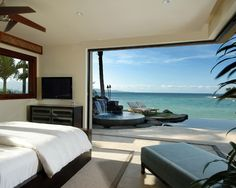 The open walls/doors are great doors, but check out that infinity pool, jacuzzi and waterfall! LOVE IT!