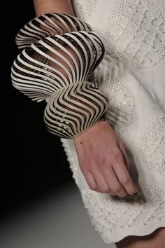 Leather swirl cuff by designer  Mary Designs from the Minas Trend Preview Show, Sao Paolo, Brazil.