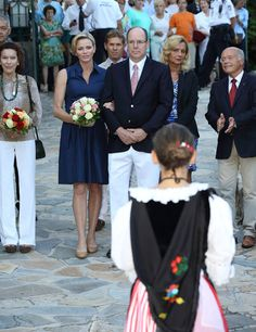 Princess Charlene and Prince Albert attended the traditional picnic of Monaco in the Princess Antoinette Park. 2 September 2014