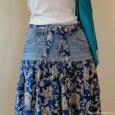 I like this idea, old jeans made into a skirt plus the matching fabric belt