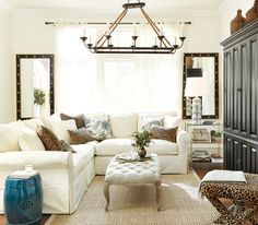 We mixed together floral and animal print throw pillows to bring personality to this family-focused living room.