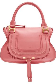The Taurus prefers to make a fashion statement in an understated way. She likes feminine colors such as pink, but she values quality-made items that'll help complete almost all of her outfits perfectly. In other words, she wants to get a lot of bang for her buck, and this magnolia Chloé Marcie bag ($1,990) is just trendy enough for her style.