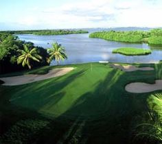 Crandon Golf Course in Key Biscayne, Florida (near Miami) ~ The perfect alternative to civilization. Spend a day enveloped by the tropics - this course is an explosion of color & light surrounded by water, mangrove forest, lush foliage & wildlife. Beauty isn't the only draw, added to its splendor, it presents a test of any golfer's skill. Von Hagge & Devlin designed it that way - a challenge from the 1st hole requiring a drive over water - through to the 18th, next to sparkling Biscayne Bay.