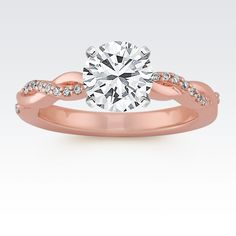 Express your love by adding a center diamond to this engagement ring featuring a swirl design. Eighteen round diamonds, at approximately .07 carat total weight, wrap around the design bringing ample sparkle to the setting crafted of quality 14 karat rose gold.