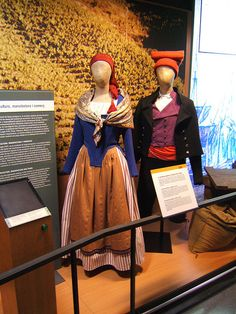 """Museu d'Història de Catalunya    Pagesos Catalans    Traditional, colorful Catalan farmer's clothes with the male hat called """"barretina"""" (almost always red, seldom purple) a very different style of """"boina"""" compared to other areas of Spain."""