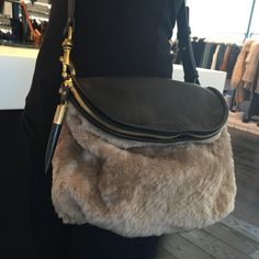 We're obsessed with this shearling Kempton & Co. cross-body bag. Beyond gorgeous. #kemptonandco #kempton #bag #purse #accessory #accessories #accessorize #fall #fall16 #fall2016 #fallfashion #fashion #style #organize #organization #musthave #wardrobeessential #shearling #crossbody #chic #hip #coolgirl #willow #willowboulder #willowloves