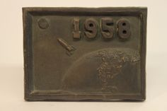 Class of 1958 bronze time capsule cover Class Design, Time Capsule, Reflection, Bronze, Cover