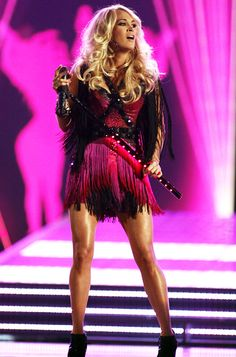The country crooner rocked the #ACM stage in a fringed #Kymerah dress and crystal-embellished #GiuseppeZanotti booties. news.instyle.com/...