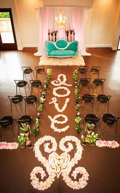 Petal aisle and teal settee backdrop. Christopher TODD Studios.