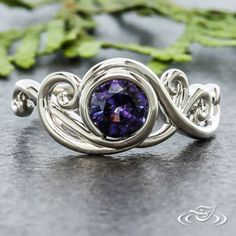 Design Your Own Unique Custom Jewelry at Green Lake Jewelry Works! Custom Platinum organic swirl vine with Purple sapphire center stone