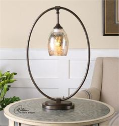 A pair of these would look great on the desks and would tie in with the chandelier!!