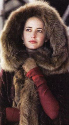 Make a giant fur hood. Fur inside and out with a fat fur scarf attached to wrap around your neck.