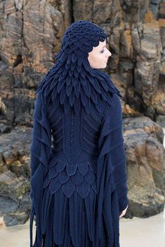 Back view of the Raven costume with its many shaped feathers. This costume was designed and hand knitted by Alice and took 5 months to complete. The Glamourie book has more of these inspiring creature costumes. There are also knitable and wearable designs with full instructions which use elements if the costumes. The Raven cardigan and poncho use the distinctive knitted raven feathers at the neckline. (from Virtual Yarns on Facebook)
