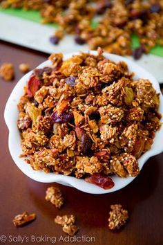 Crunchy Apple Spice Granola packed with quinoa, almonds, maple, and cinnamon. Healthy snack by sallysbakingaddiction.com