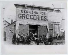 1884~ Geo. Jennings Grocery Store located on the corner of 5th Avenue and Main Street, Bismarck.