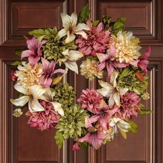 White Tulips with Ivy Wreath: a gorgeous wreath arrangement as a Spring Front Door Wreath, Wedding Wreath Decoration. Also makes a wonderful Housewarming Gift ! The Tulip Wreath is handcrafted with hundreds of artificial tulips. This wreaths diameter is measured at the widest edge