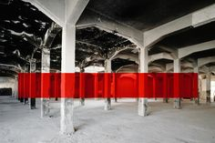Georges Rousse is a French photographer and installation artist. He paints geometric shapes in abandoned places and photographs them creating very intriguing optical illusions.