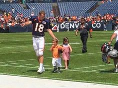 """""""Daddy"""" Manning with his twins."""
