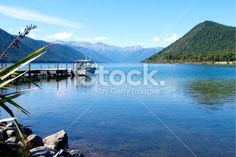 Looking down the pier to the distant Sabine Ranges at Lake Rotoroa,. Image Now, Lakes, National Parks, Royalty Free Stock Photos, Mountains, Beach, Photography, Travel, Outdoor