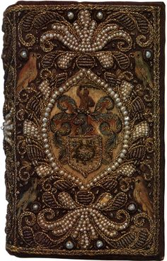 An embroidered binding in purple satin with seed perls and bullion on a copy of The Whole Book of Psalms, London, 1641. Lessing J. Rosenwald Collection, Library of Congress. (8.2 cm. by 5 cm. by 2.5 cm)