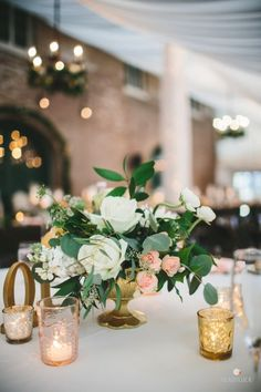 Candle lit wedding table decor: http://www.stylemepretty.com/maryland-weddings/baltimore/2015/11/24/romantic-evergreen-museum-and-library-wedding/ | Photography: Readyluck - http://www.readyluck.com/
