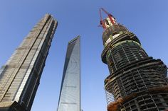 """SHANGHAI - The """"Shanghai Tower,"""" which is currently under construction in the eastern metropolis of Shanghai and will stand as China's tallest building upon completion, reached 303.5 meters on Tuesday."""
