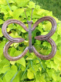 Hey, I found this really awesome Etsy listing at https://www.etsy.com/listing/244505329/horse-shoe-butterfly-garden-art-rusty